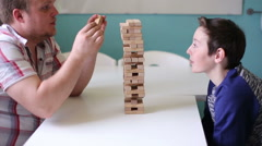 Man and teen Playing in Board Game at the Table Stock Footage