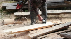 Carpenter polishing timber using electric grinder Stock Footage