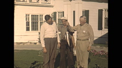 Vintage 16mm film, 1948, Quebec, men proudly holding caught fish Stock Footage