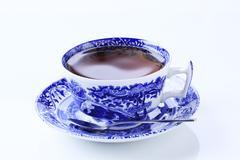Hot tea in an ornate teacup Stock Photos