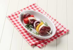 Raw beef shish kebab in a casserole dish - stock photo