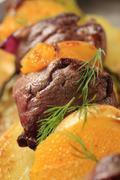 Shish kebab with oranges - stock photo