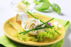 Swirl of cheese spread on a spoon Stock Photos
