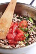 Preparing ragu alla Bolognese in a pan - detail Stock Photos