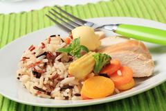 Healthy dish of mixed rice, chicken meat  and vegetables Stock Photos