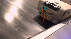 Luggage travels on a conveyor belt at the airport Stock Footage