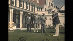 Vintage 16mm film, 1948, Quebec, dapper men putting golf, Tadoussac Hotel Stock Footage