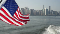 New York skyline and American flag Stock Footage