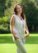 Wholesome woman smiling in the park - stock photo