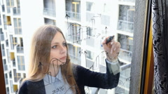 Lifestyle: beautiful young woman drawing math business graphs on the glass with Stock Footage