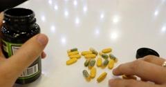 Man hand take pills Stock Footage