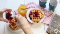 Waffles with honey and berries Stock Footage