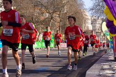 LONDON - APRIL 13: Unidentified children run the London marathon on April 13t Stock Photos