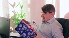 Young Businessman gets christmas gift Stock Footage