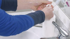Soap dispenser: woman washing hands thoroughly Stock Footage
