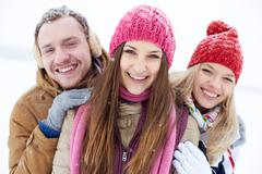 Friends in winter-wear - stock photo