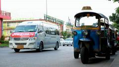 Rickshaws parked on the road near the curb Stock Footage