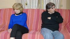 mature couple on the sofa after a quarrel: couple crisis, divorce  - stock footage