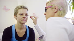 Woman visit eyelash extension artist 4K Stock Footage