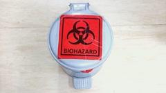 waste bin with biohazard sign - stock footage