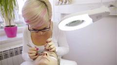 Professional beauty master working on customer eyelashes 4K Stock Footage