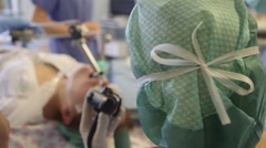 Larynx surgery in operating theatre Stock Footage