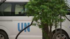United Nations minivan door closed Stock Footage