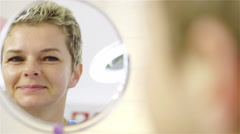 Woman looking herself in small mirror 4K Stock Footage