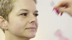 Combing women new long eyelashes 4K Stock Footage