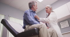 Good-looking mid-aged male patient having doctor checkup Stock Footage