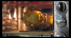 Rotisserie chicken in oven Stock Footage