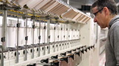 Engineer Controlling Manufacturing Process in Textile Industry Stock Footage