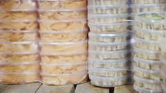 Many packages of canned fish Stock Footage