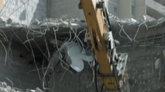 Low angle view of digger demolishing a house Stock Footage