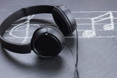 Music notes with  headphones - stock photo