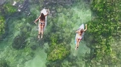 Surfing Girls Aerial Zoom slow motion Stock Footage
