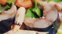 Juicy pieces of fish with shrimp and tomatoes Stock Footage