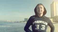 Sportman on the city beach Stock Footage