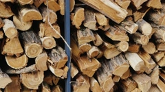 Bundles of firewood lying in a large array Stock Footage