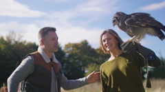 4K Visitors to a falconry centre taking a photo of a Verreaux's eagle owl Stock Footage