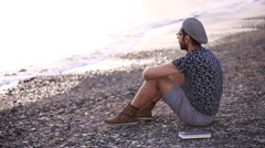 Man relaxing on the beach Stock Footage