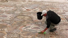 LOD, ISRAEL: Israeli Antiquities Authority unveiled Byzantine era mosaic floor Stock Footage