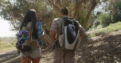 Mexican couple hiking outdoors together Stock Footage