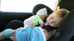 Baby sleeping with dolls in baby car seat Stock Footage