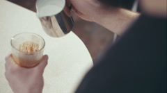 Cool trendy barista making cappuccino cool shadows natural light background Stock Footage