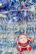 Stock Photo of Santa Claus on tinsel  background