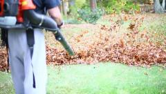 MAN BLOWING LEAVES 1 SLO MO - stock footage