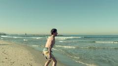 Sportman on the beach Stock Footage