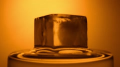 Time lapse of melting of ice cube Stock Footage