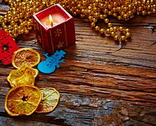 Seasonal rustic Christmas border composed of ornaments over a wooden background - stock photo